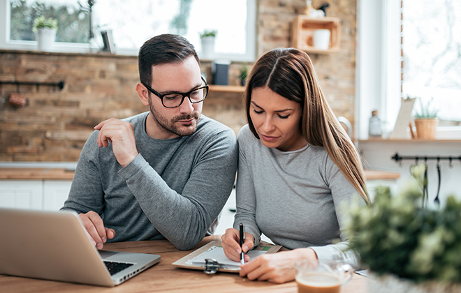 couple reviewing financials and budgeting